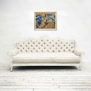 Chicken feather wall art hung over white living room couch