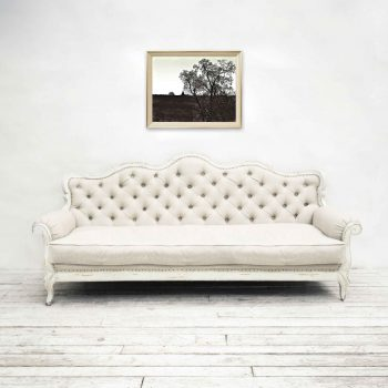 Black and white barn hung over farmhouse couch